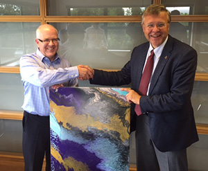HMG Paints John Falder presenting painting to Doodsons Neil Clayton